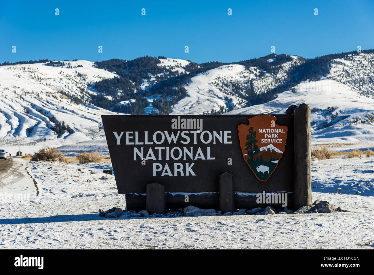 Yellowstone National Park Sign At The Entrance In Winter