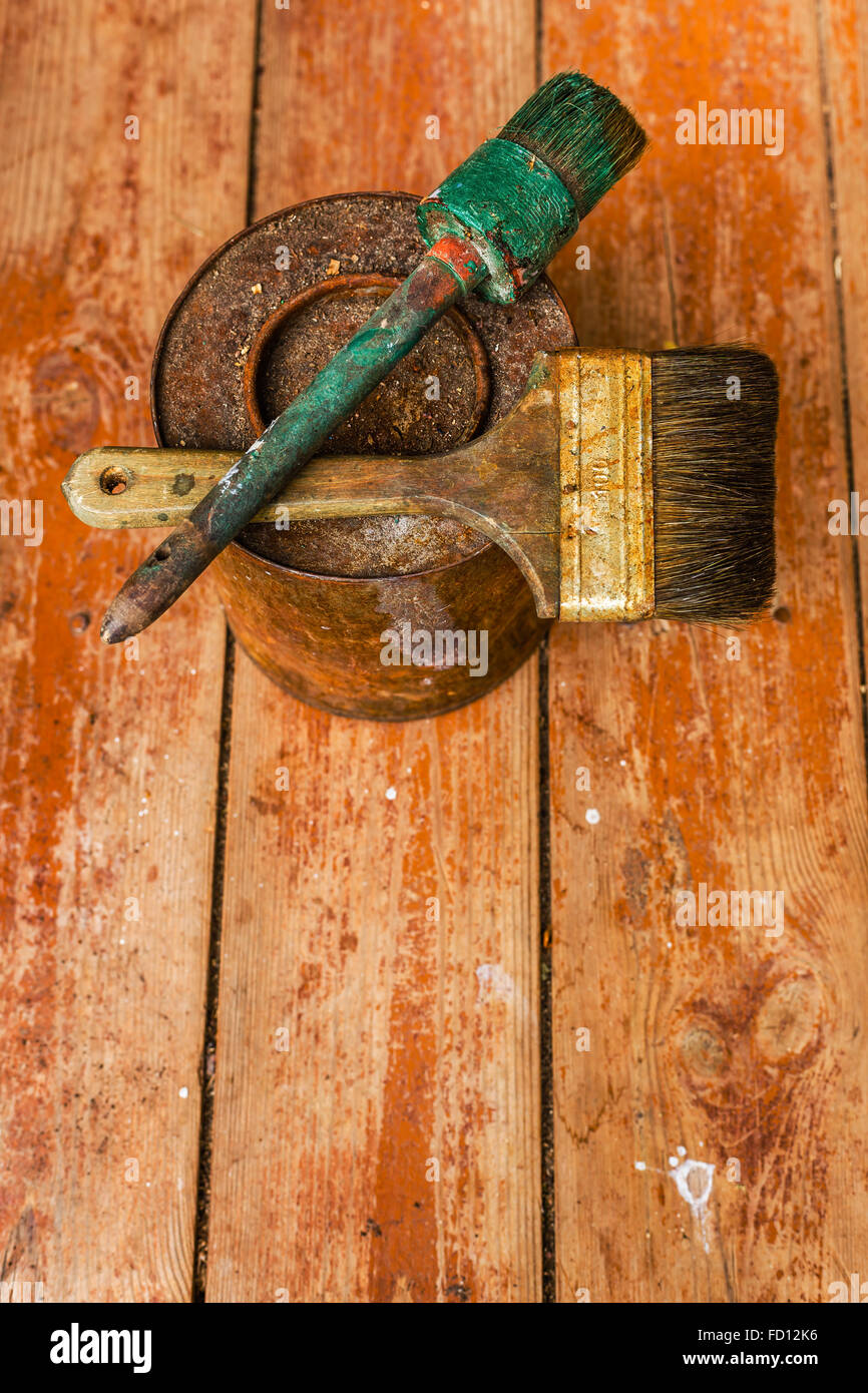 Spoiled old tools on a wooden floor. - Stock Image