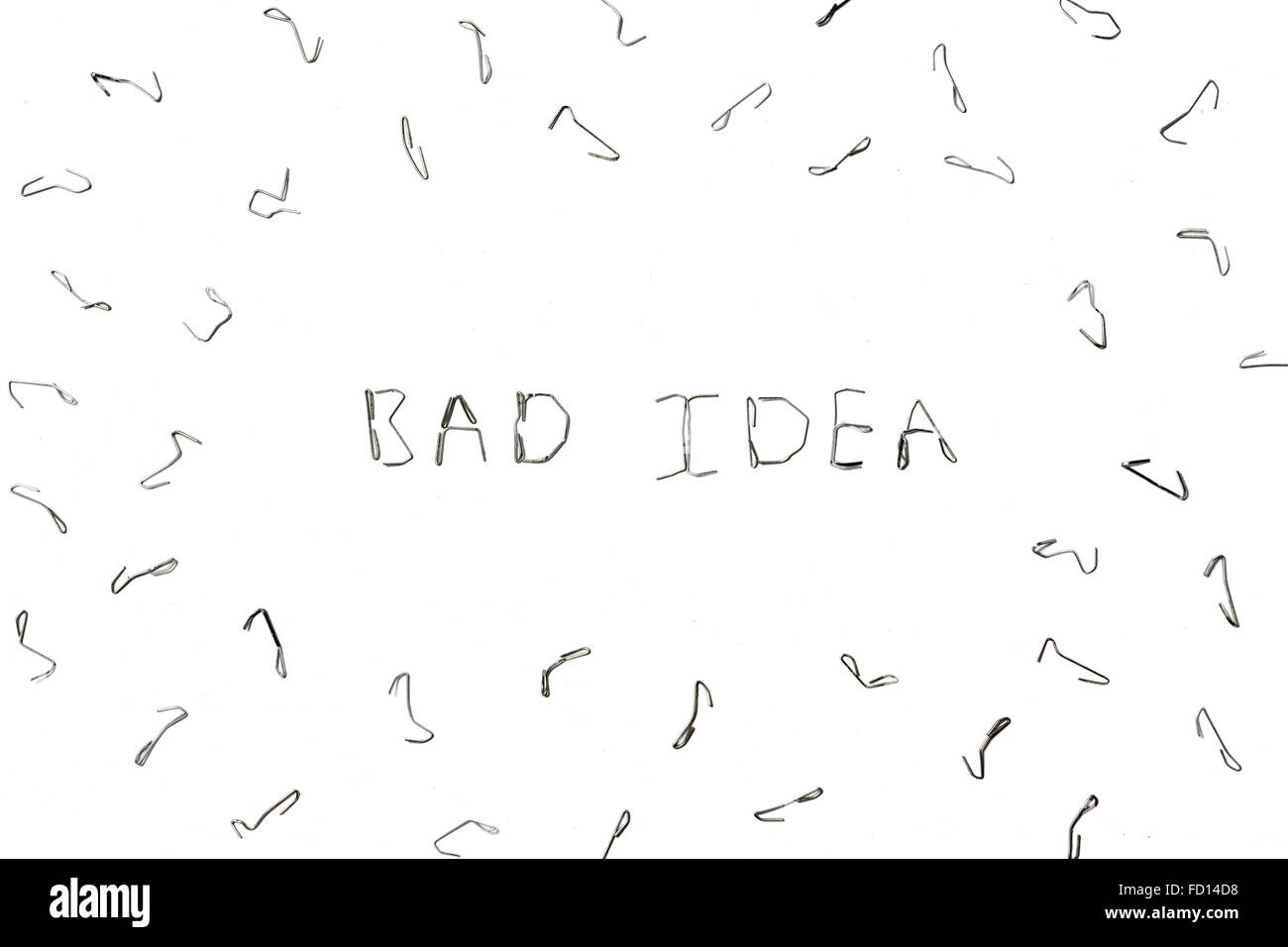 The inscription Bad idea from the damaged staples - Stock Image
