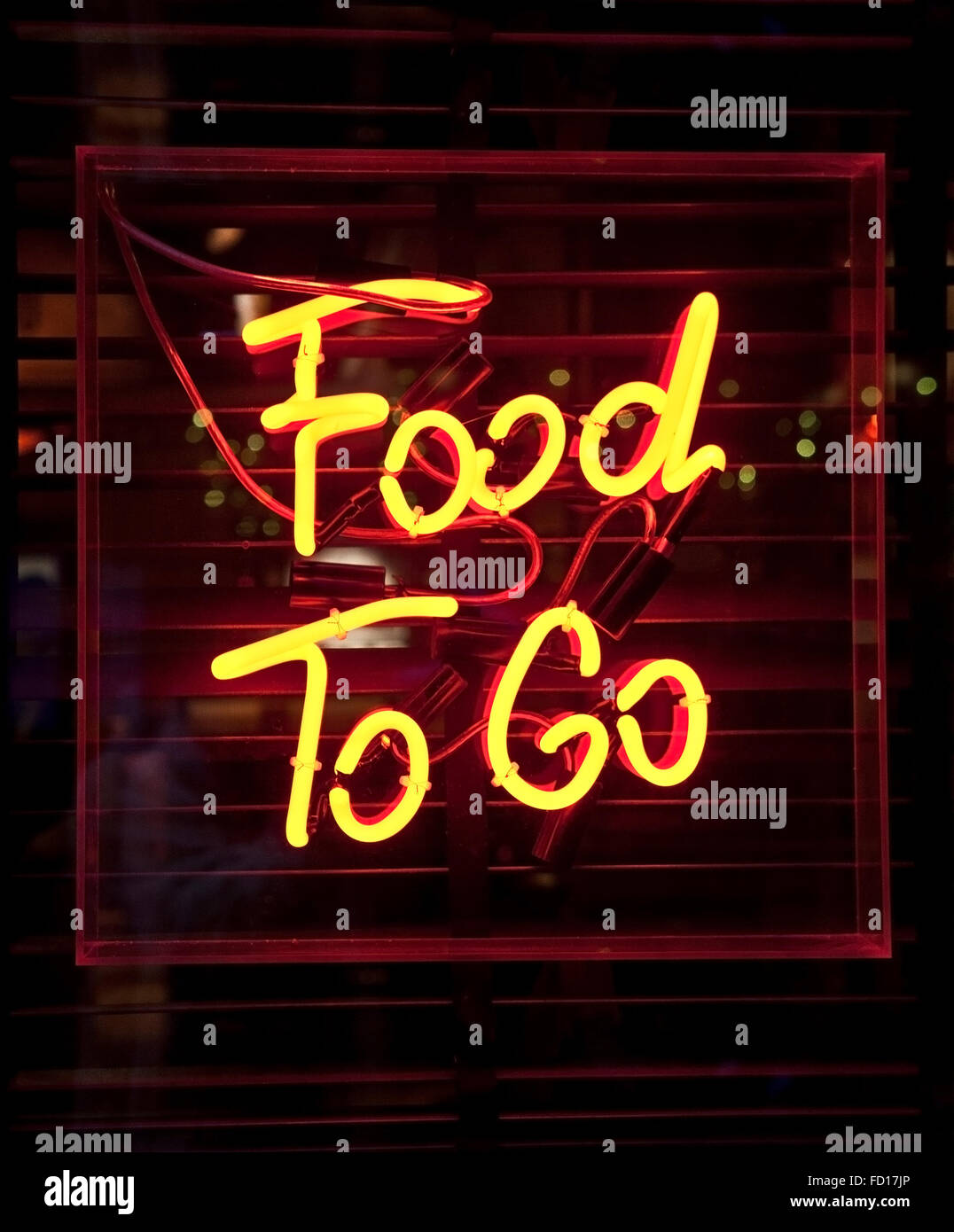 Food To Go neon sign - Stock Image