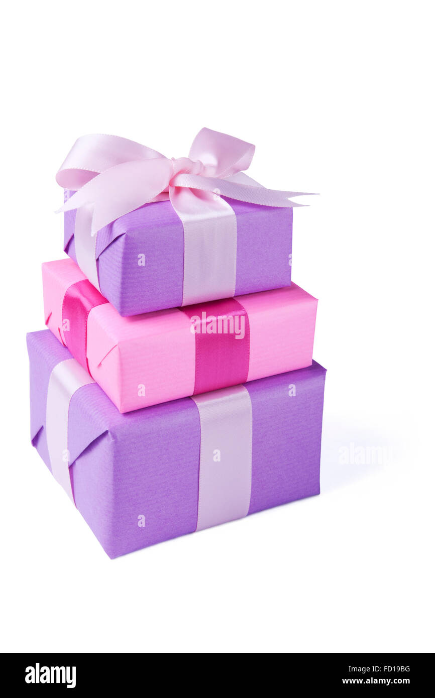 A stack of pink and purple Valentine's gifts with a satin ribbons. Isolated on white. - Stock Image