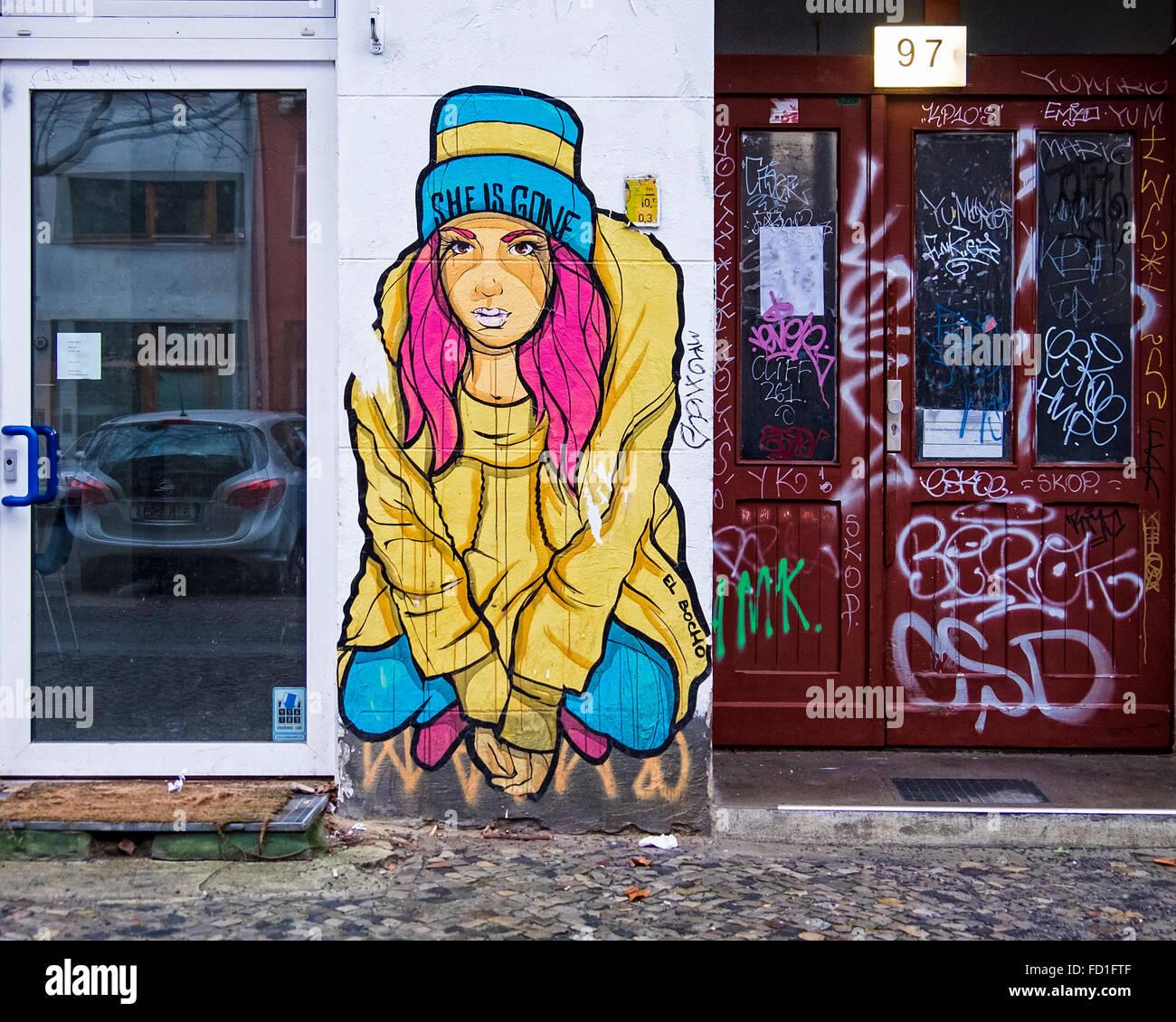 Berlin graffiti street art. Pink haired woman by street artist, 'El Bocho' - Stock Image