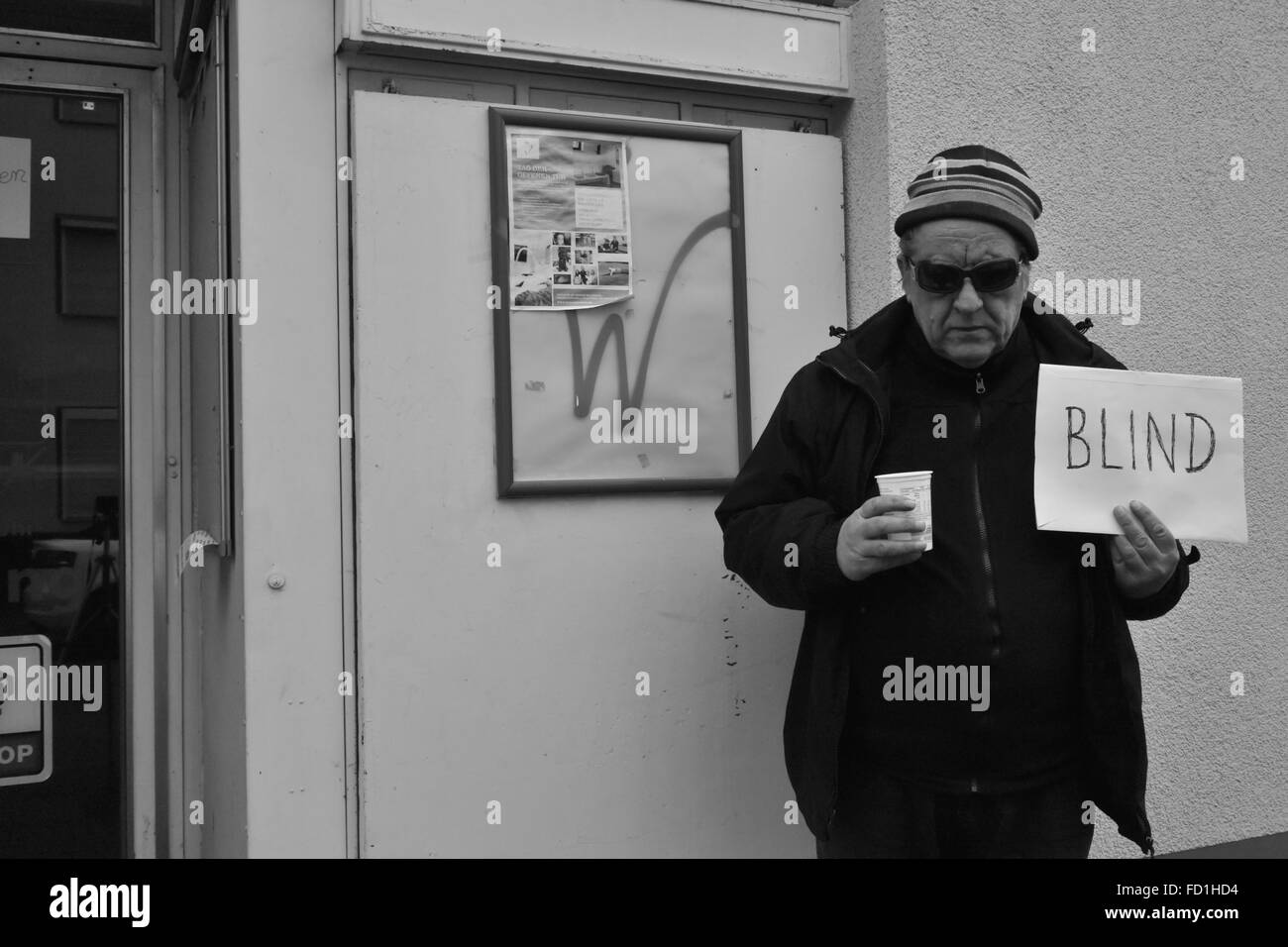 blind beggar on the street in Bonn, south town, Germany - Stock Image