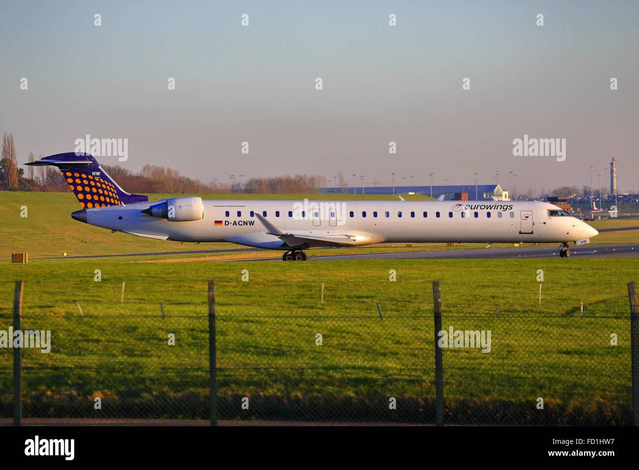 Eurowing Canadair CRJ-900 D-ACNW taking off at Birmingham Airport, UK - Stock Image