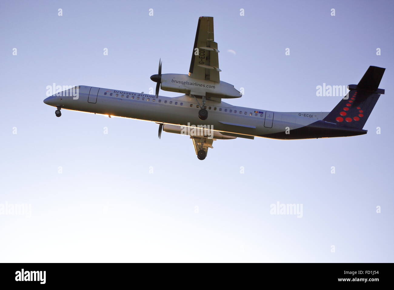 Brussels Airlines Dash-8 G-ECOI landing at Birmingham Airport, UK - Stock Image
