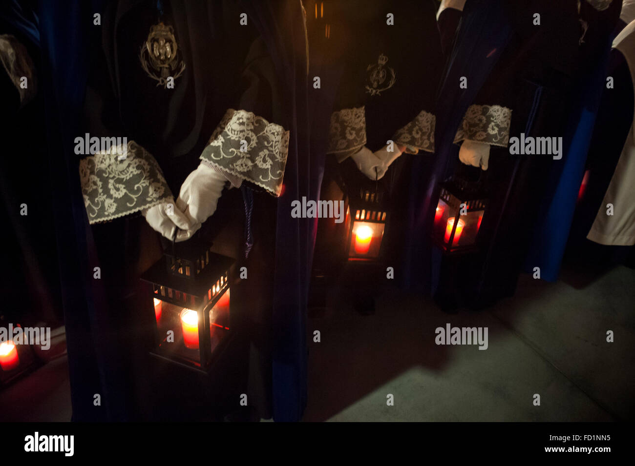 Detail Nazarenes carrying lanterns Night procession the Christ of prayer which takes place the evening of Easter Stock Photo