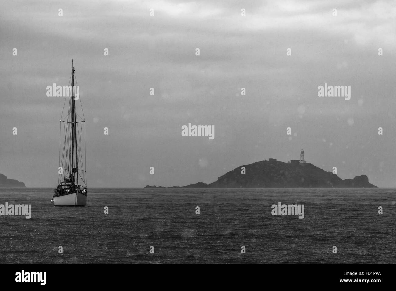 A sailing boat anchoring on Scilly Isles - Stock Image