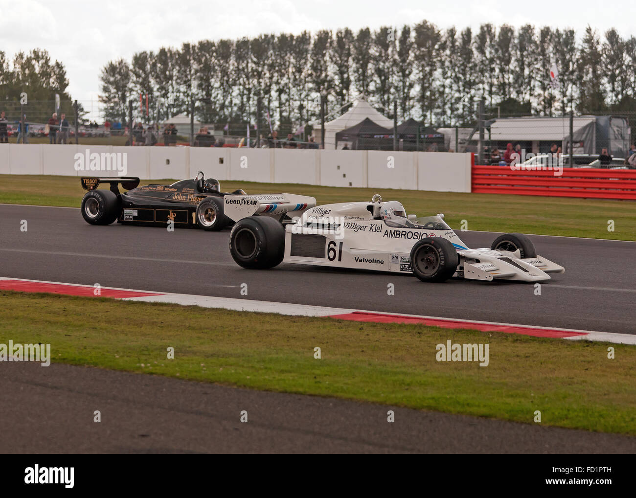 A Shadow DN8 racing against a Lotus 91/5 during the FIA Masters Historic Formula One Race at the Silverstone Classic, - Stock Image