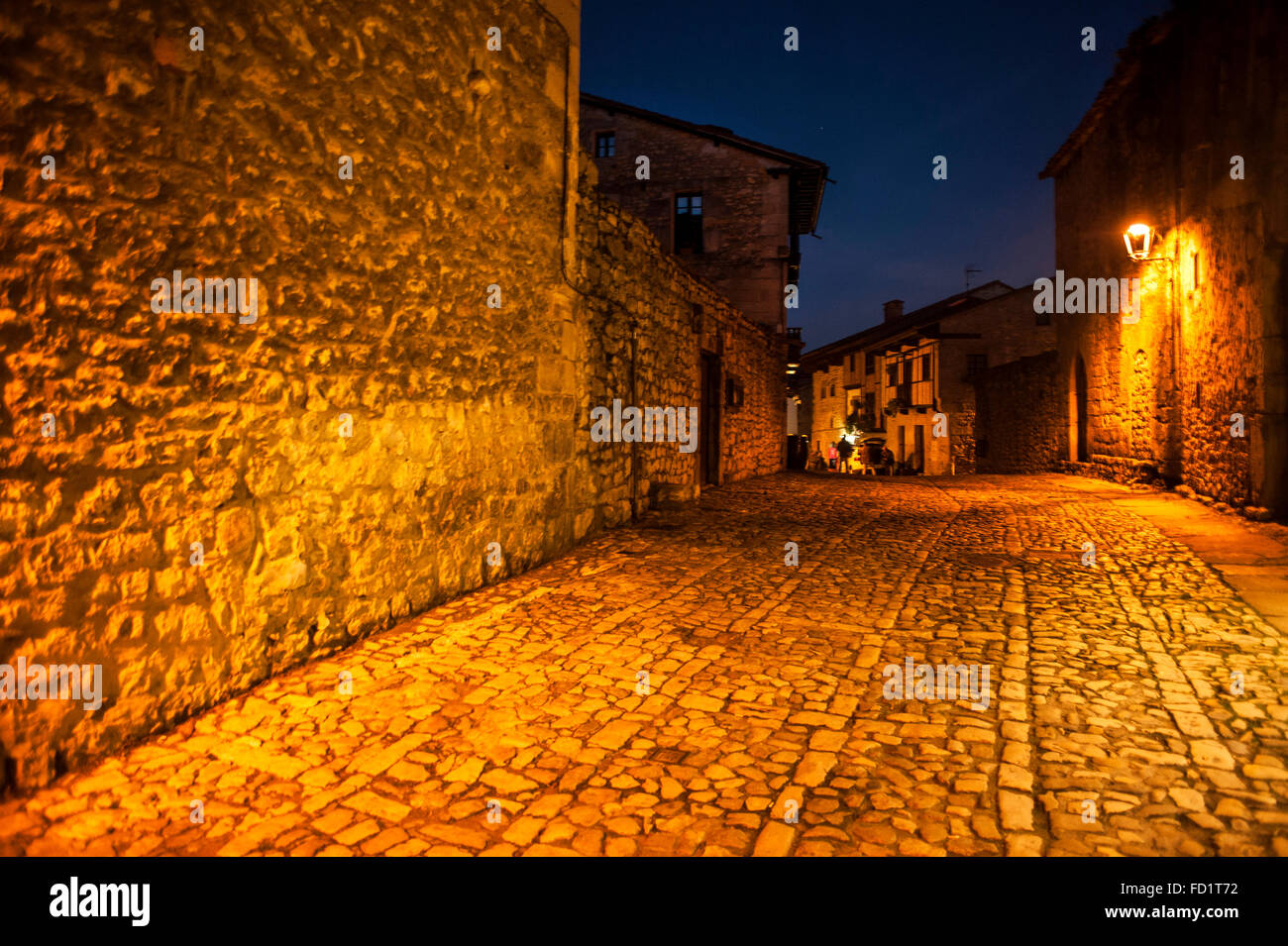 View of the typical narrow cobbled streets of the medieval village of Santillana del Mar Stock Photo