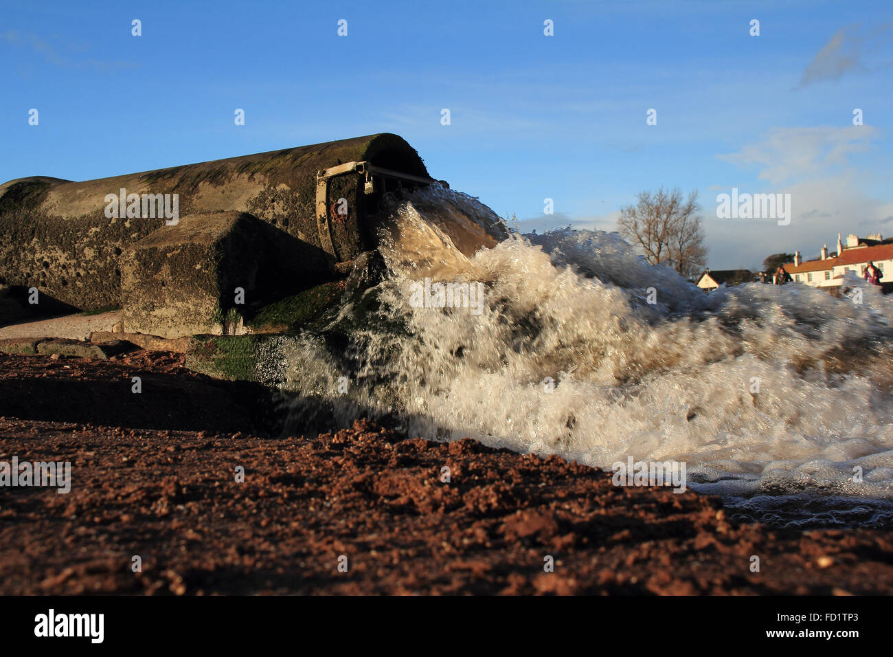 Land drainage pipe spewing dirty water on to a holiday beach in Paignton,Devon,Southwest England - Stock Image