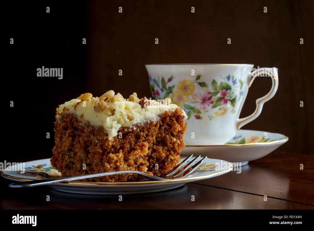 Tea and carrot cake on china crockery - Stock Image