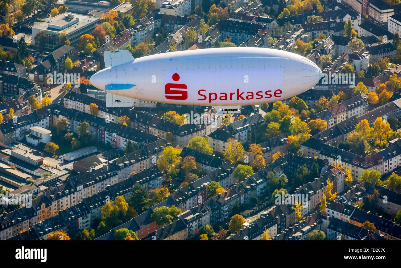 Sparkasse blimp advertising above Rüttenscheid, Essen, Ruhr district, North Rhine-Westphalia, Germany - Stock Image