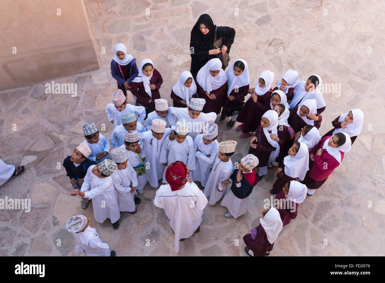 Omani school children visiting Nizwa Fort in Oman - Stock Image