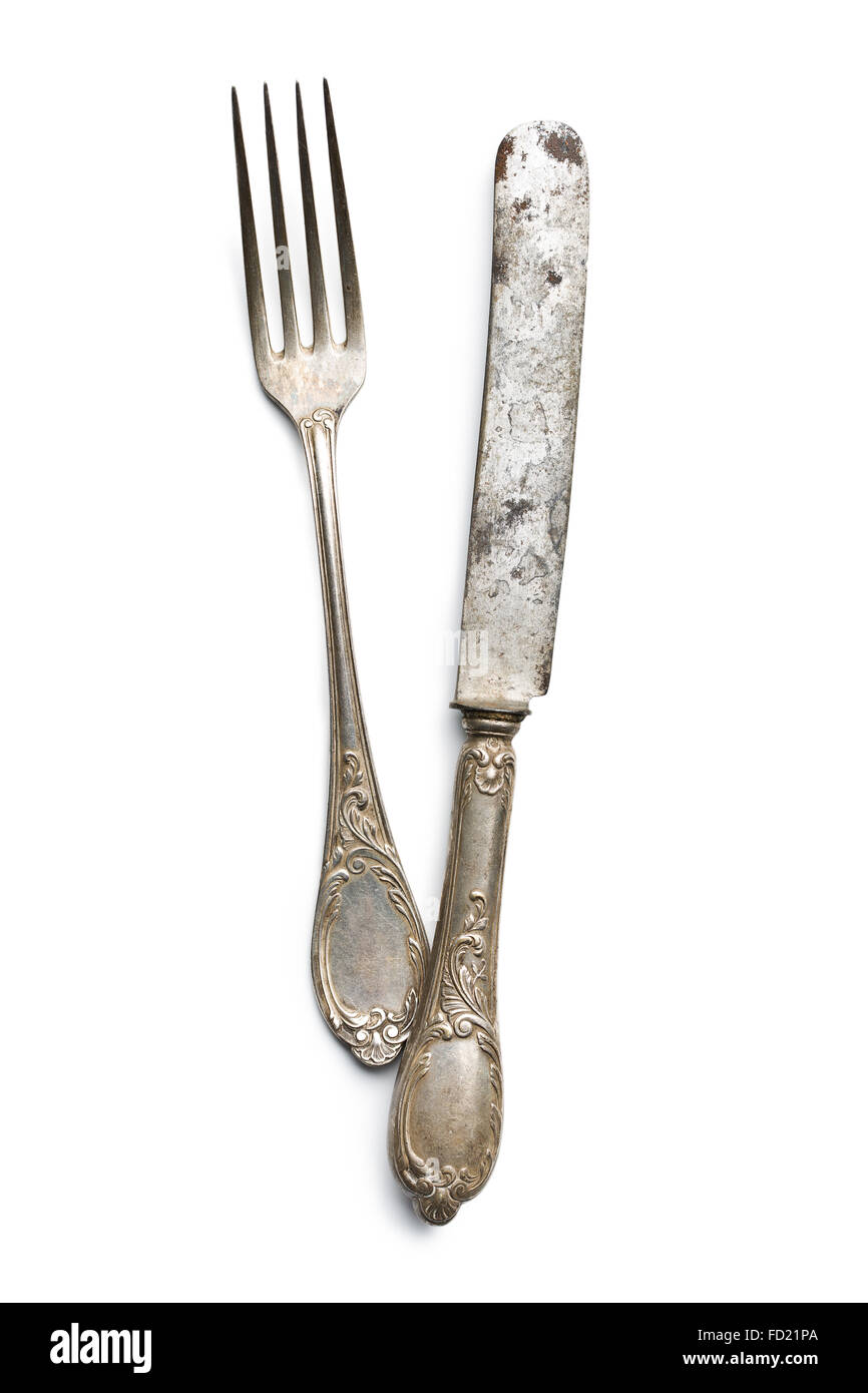 old vintage knife and fork on white background - Stock Image