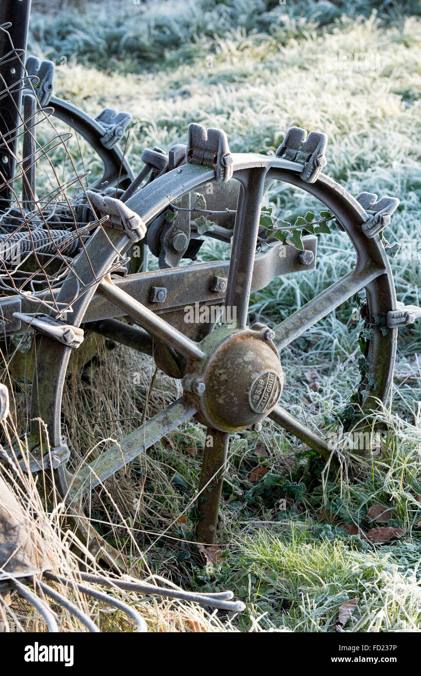 Frost on a vintage bamford potato spinner in an allotment. UK - Stock Image