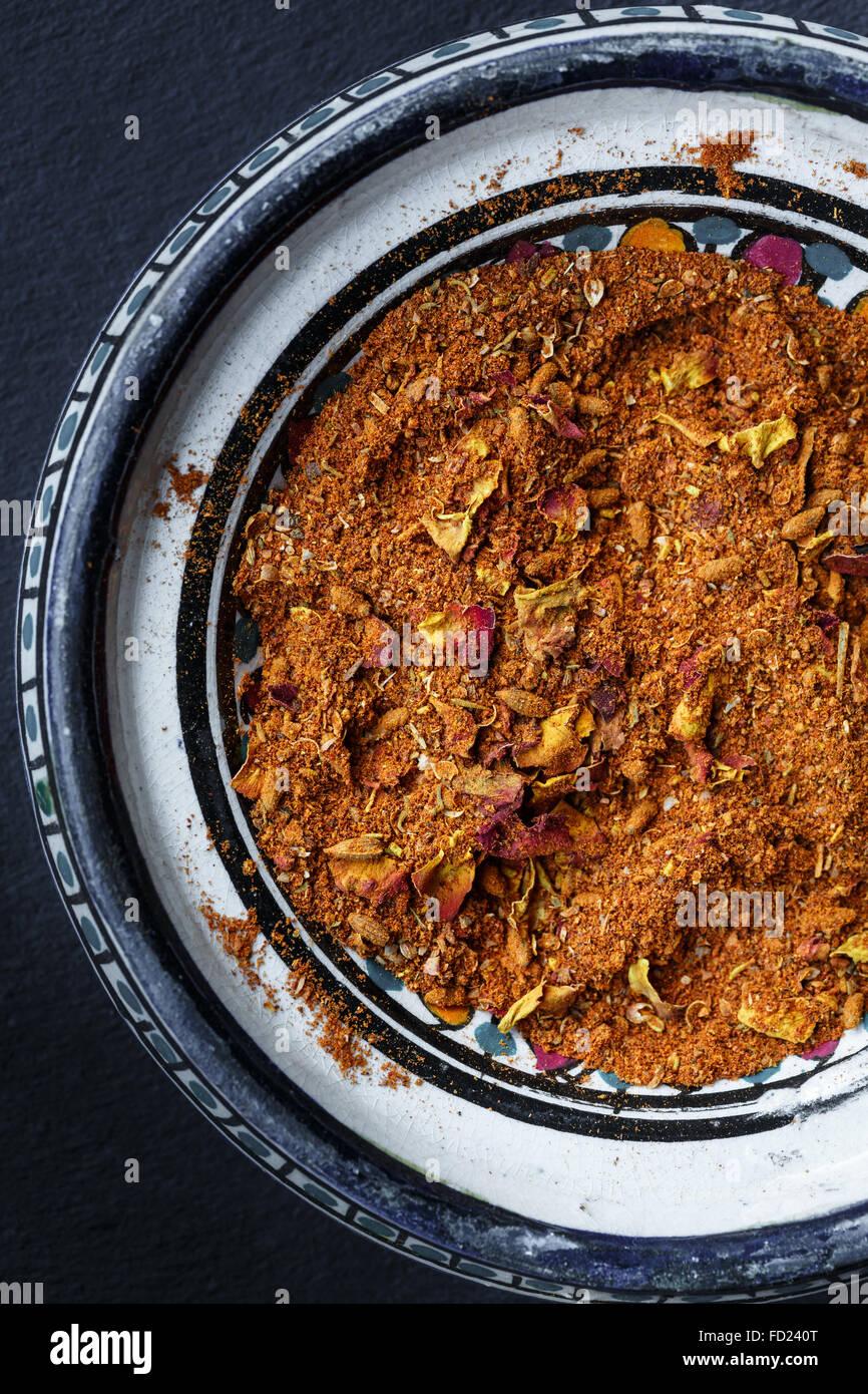 Ras el hanout (Moroccan spice mixture) in a bowl - Stock Image