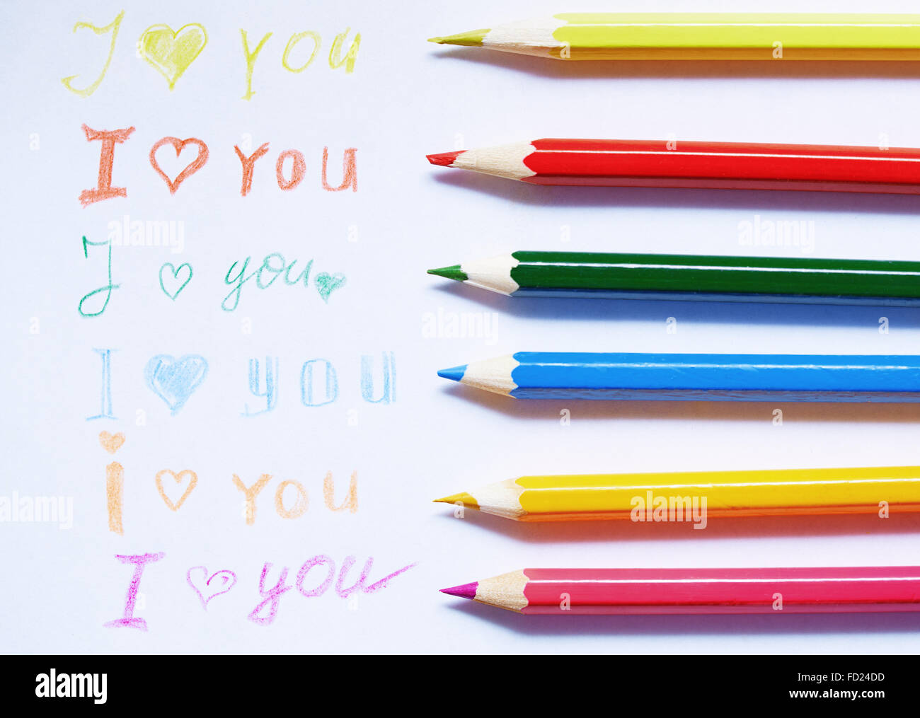 Paper with love you message and colored pencils - Stock Image