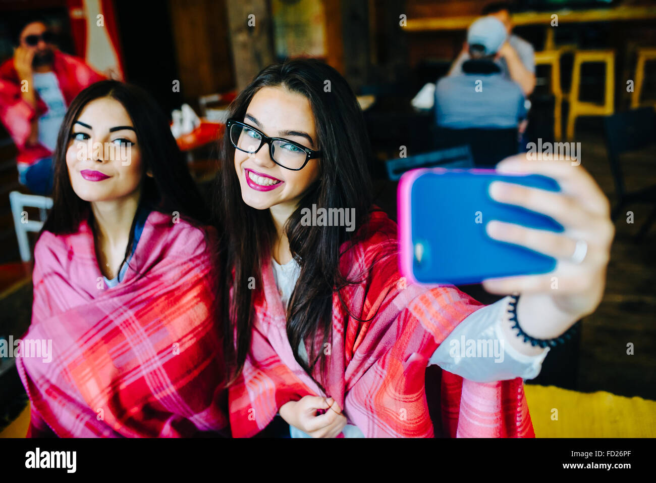 two close friends do selfie in the cafe - Stock Image