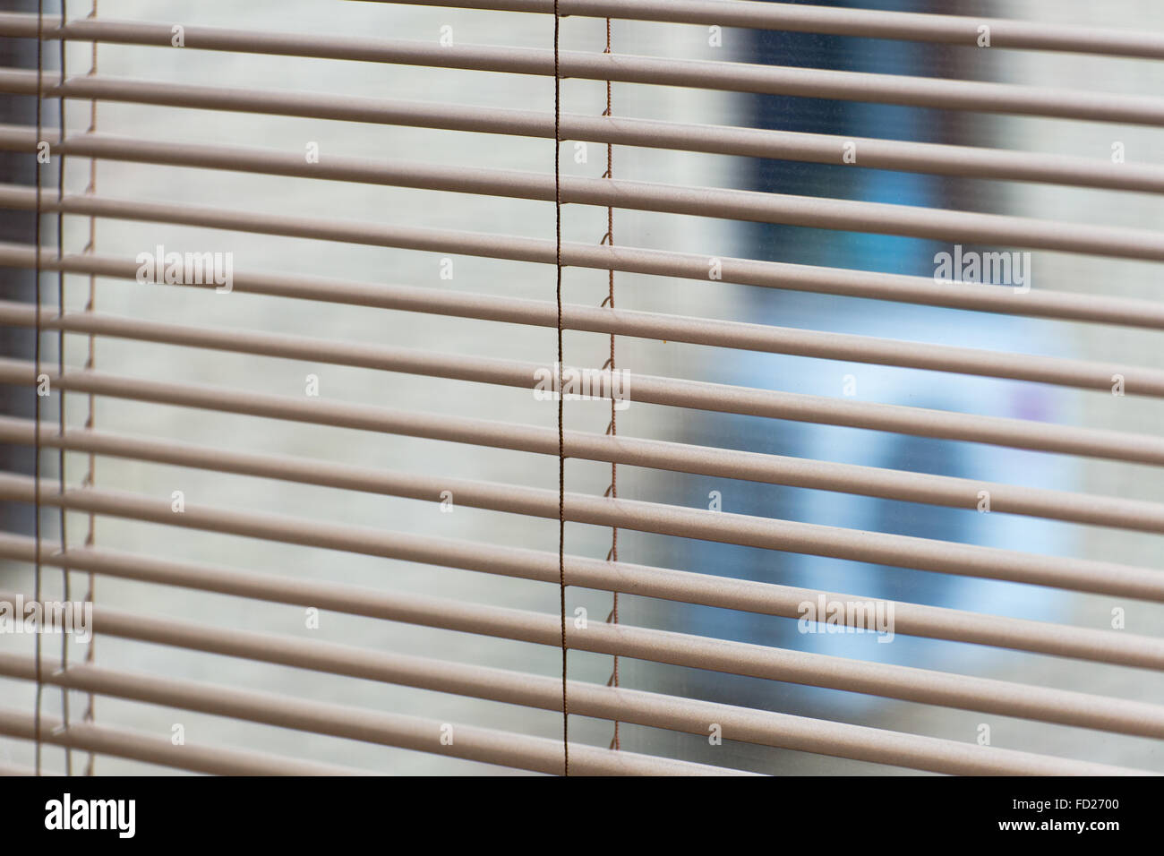 Venetian open blinds, close up image as background on the home window.  Opened  jalousie, gray alu metal shutters. Stock Photo
