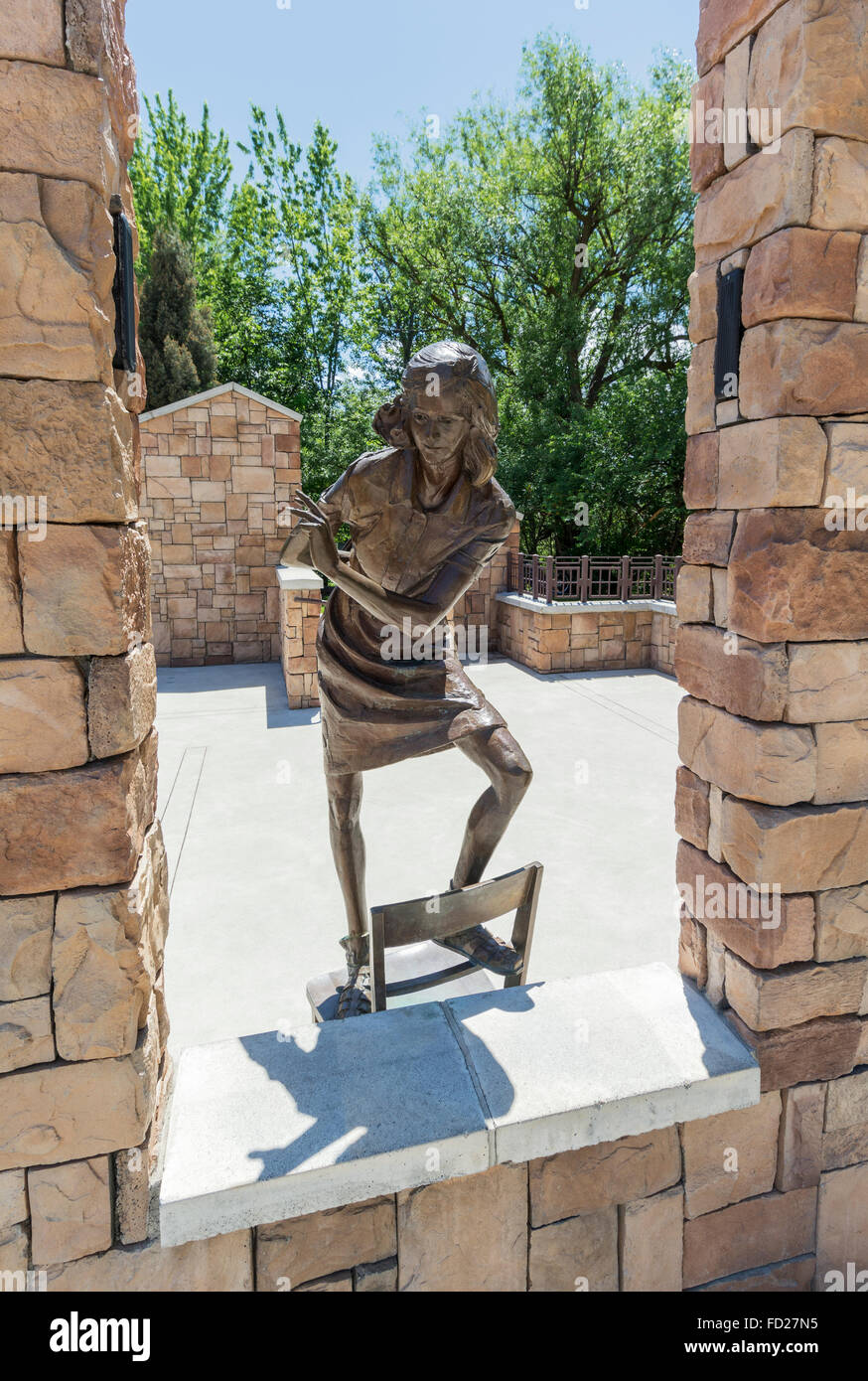 Idaho, Boise, Idaho Anne Frank Human Rights Memorial, life size bronze sculpture of Frank holding diary - Stock Image