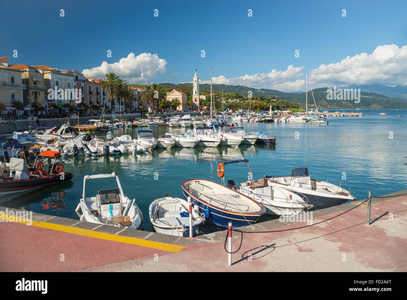 Motor boats and yachts in the harbor of Scario on a sunny summer day in the mediterranean sea, Cilento, Campania, - Stock Image
