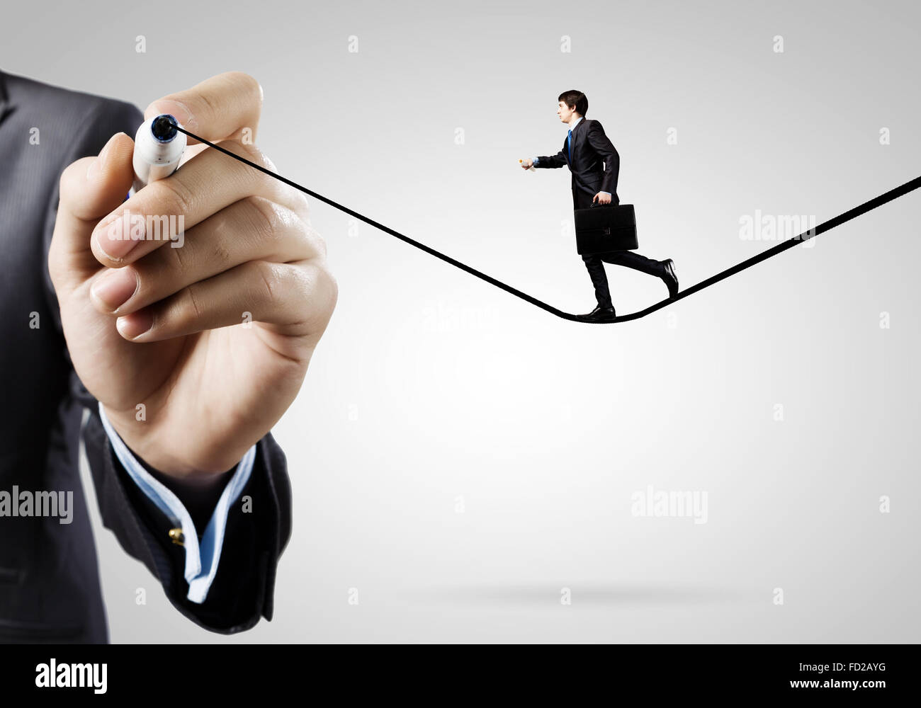 Businessman walking on drawn line. Risk concept - Stock Image