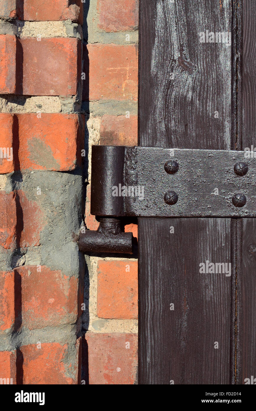 Old Door Hinge On Wooden Door Closeup   Stock Image