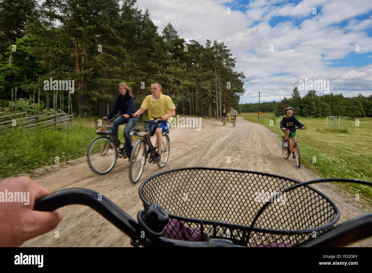 Cyclists on Utö  island. Stockholm archipelago. Sweden - Stock Image