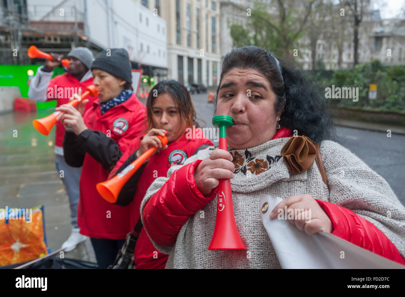 London, UK. 27th January, 2016. Grass-roots union IWGB hold a noisy protest and blow vuvuzelas outside CBRE-managed - Stock Image