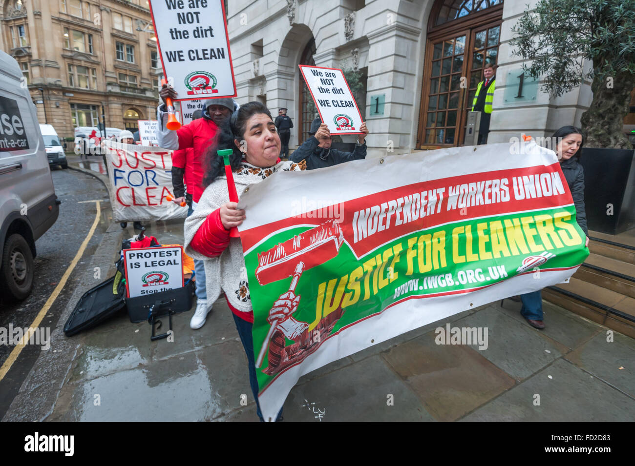 London, UK. 27th January, 2016. Grass-roots union IWGB hold a noisy protest and walk up and down outside CBRE-managed - Stock Image