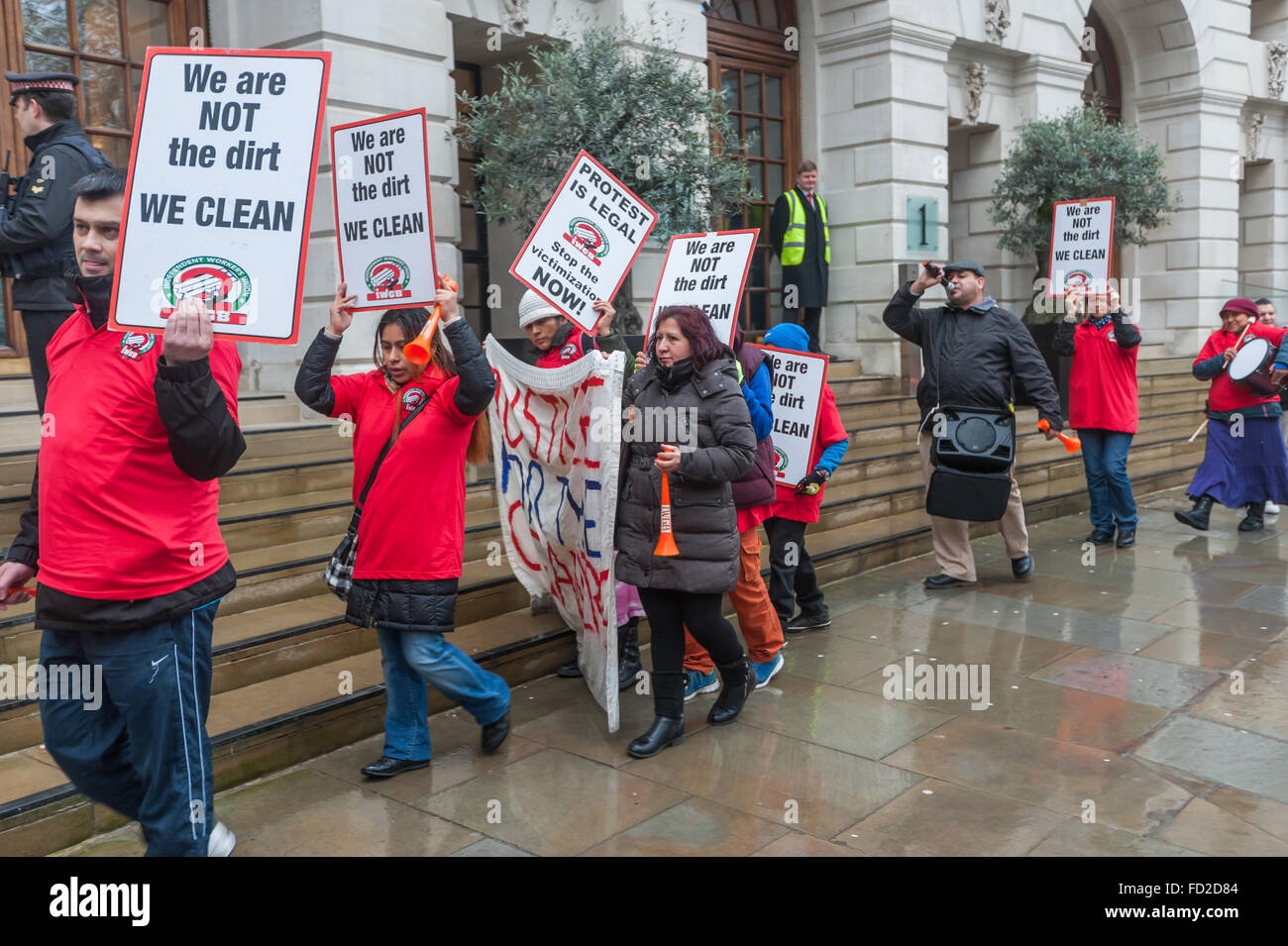 London, UK. 27th January, 2016. Grass-roots union IWGB hold a noisy protest and walk along the pavement outside - Stock Image