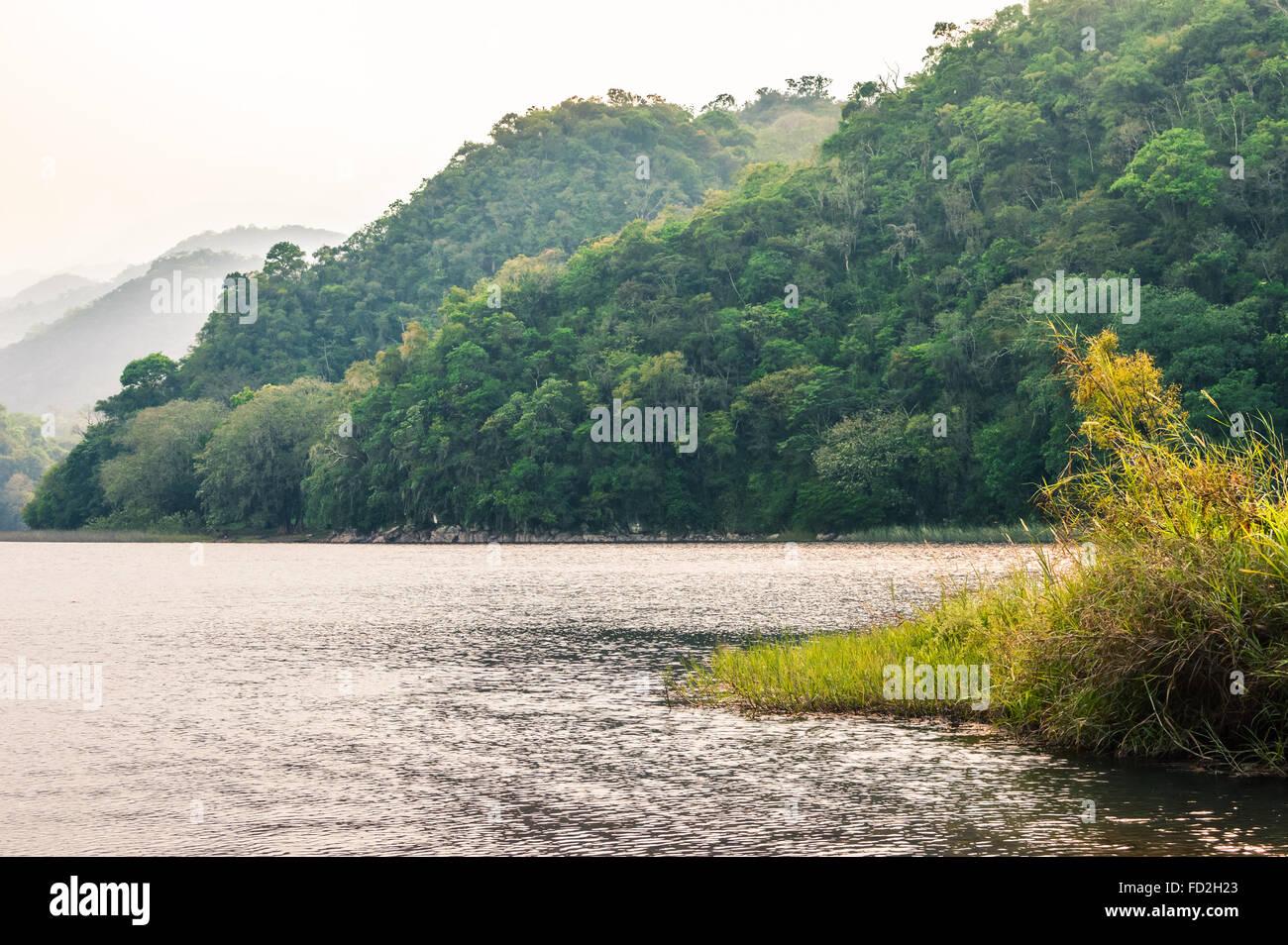 Hazy landscape of Lake de  Yojoa in Honduras Stock Photo