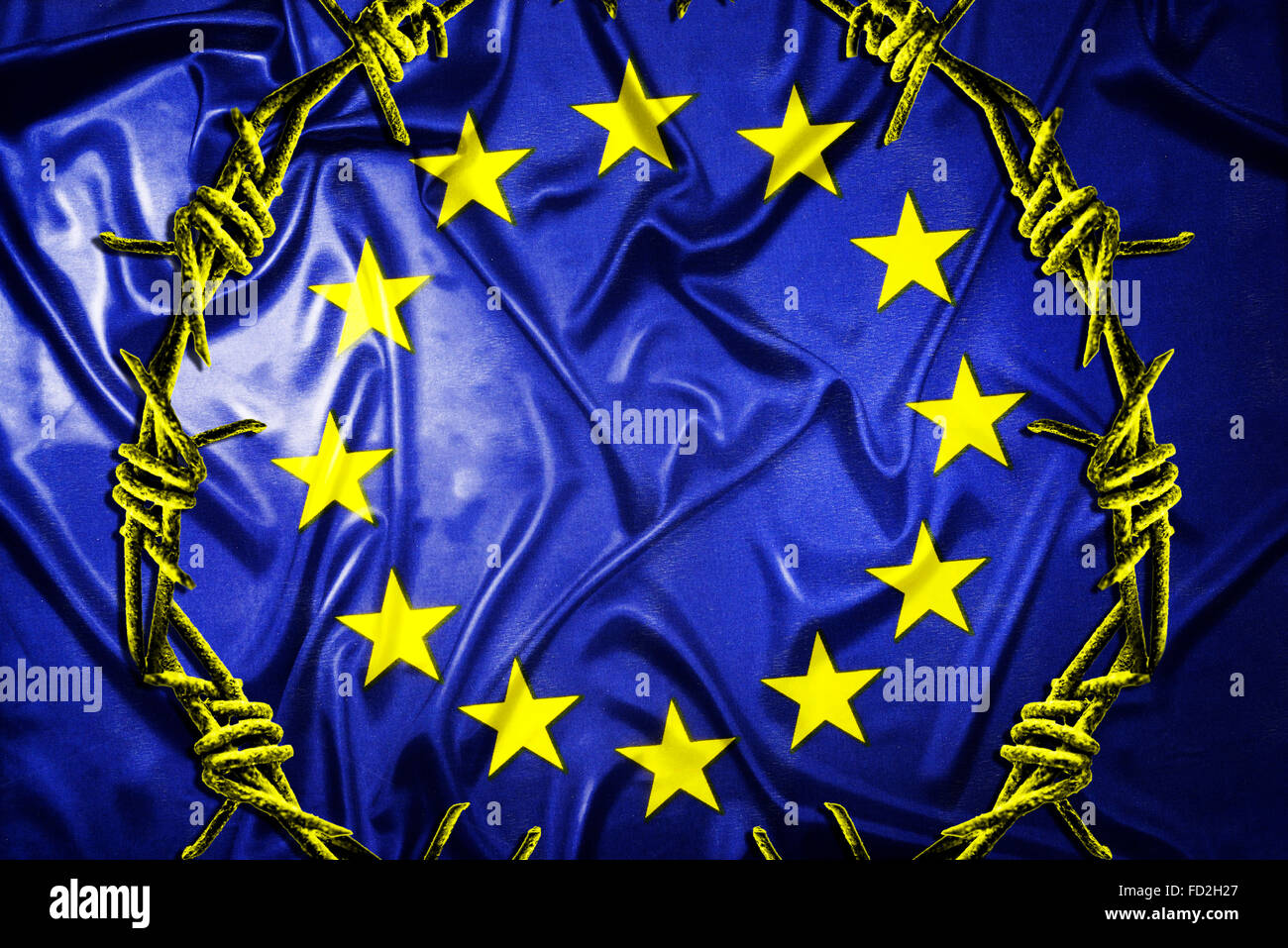 Flag of the European Union and barbed wire, refugee crisis - Stock Image