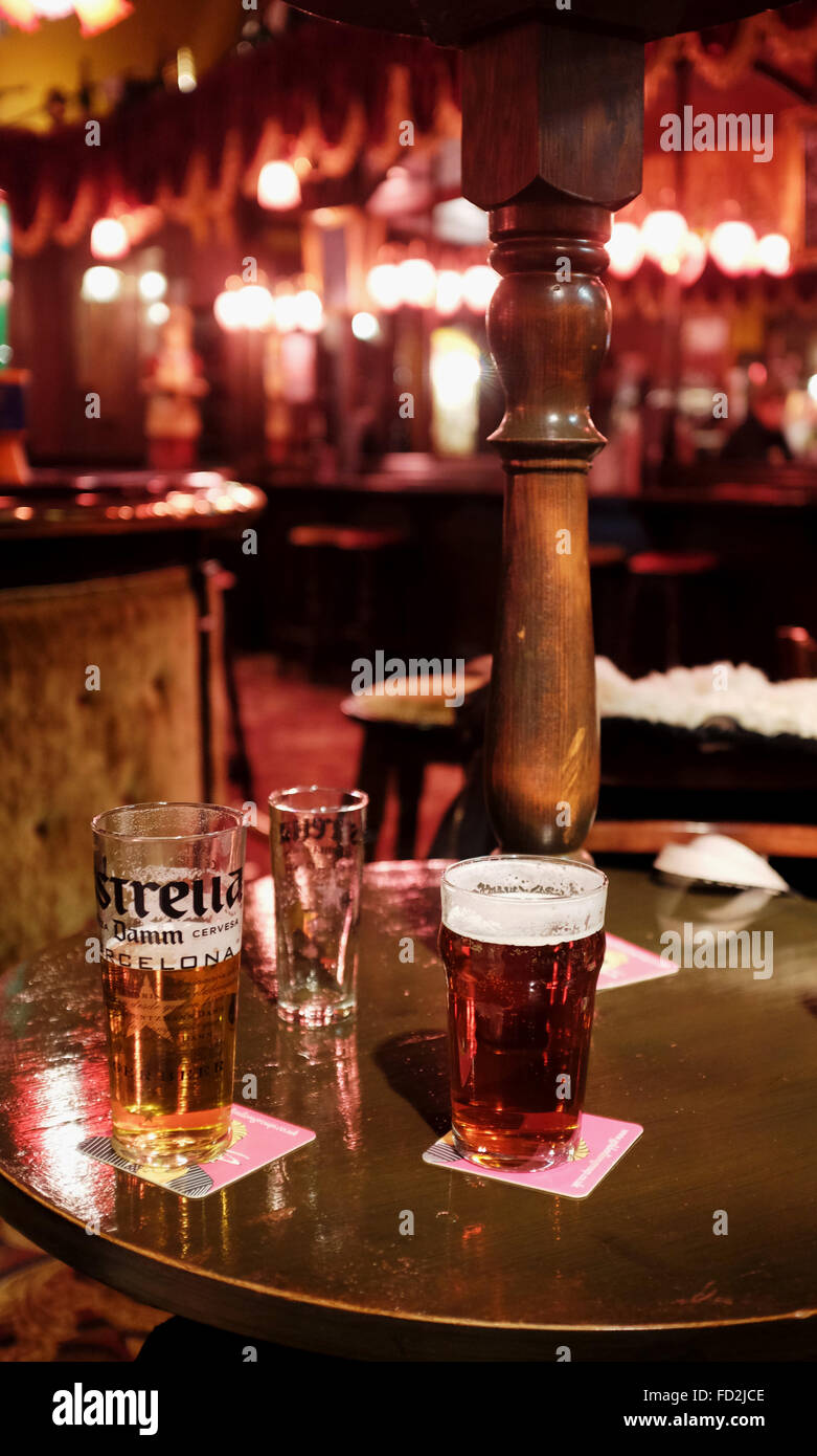 Pint of Estrella Lager and pint of real ale in a pub - Stock Image