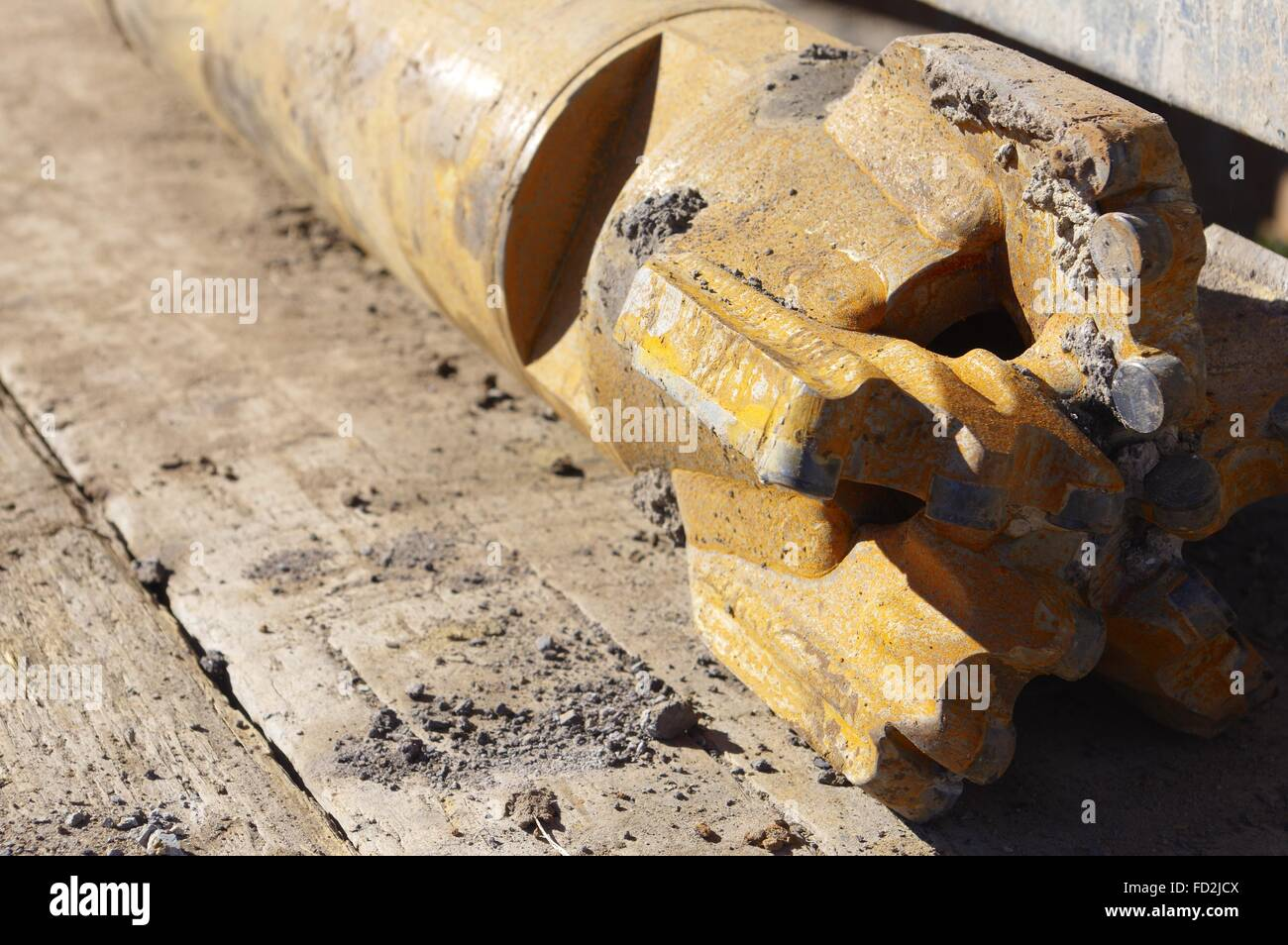 Close-up of used drilling bit on the back of a drill rig. - Stock Image