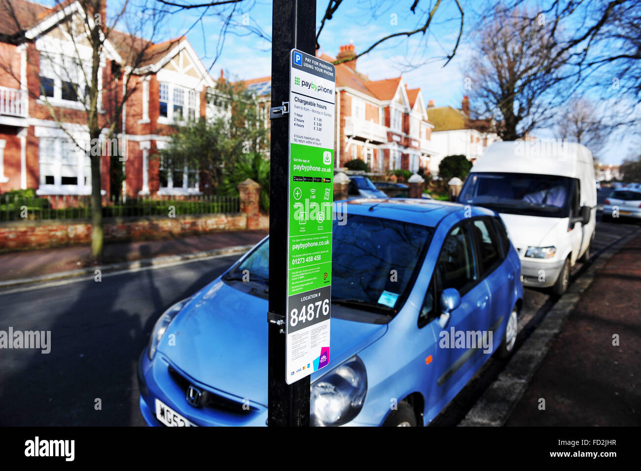 New PaybyPhone street car parking charges sign in Brighton and Hove UK - Stock Image