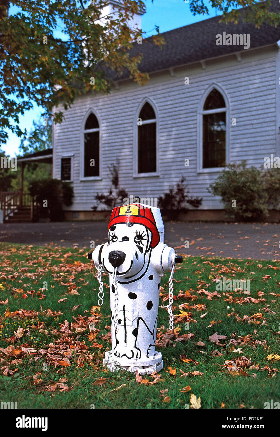 Painted and decorated doggy fire hydrant,New Carlisle,Gaspe Peninsula,Quebec - Stock Image
