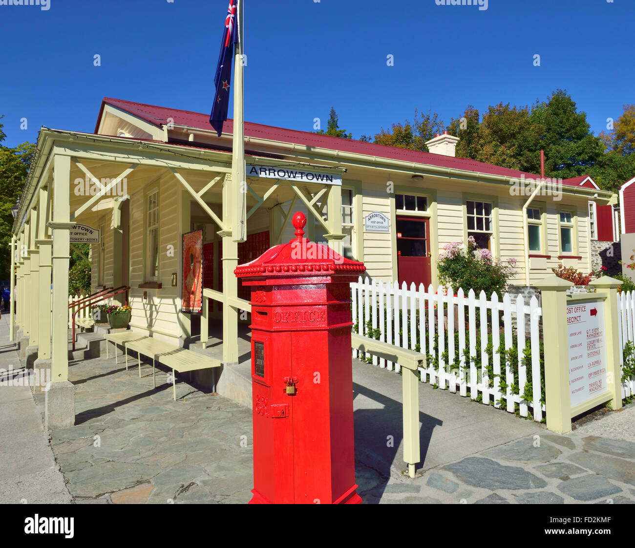 A red letter box in front The Old Post Office in the Main street Arrow Town , Otago region of the South Island of Stock Photo