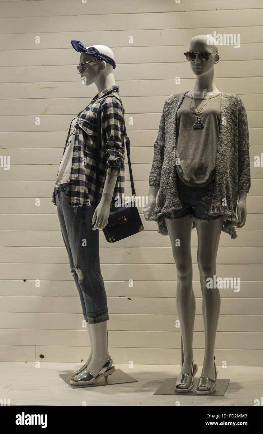 View of some models in a windowshop of a central street of Madrid city, Spain - Stock Image
