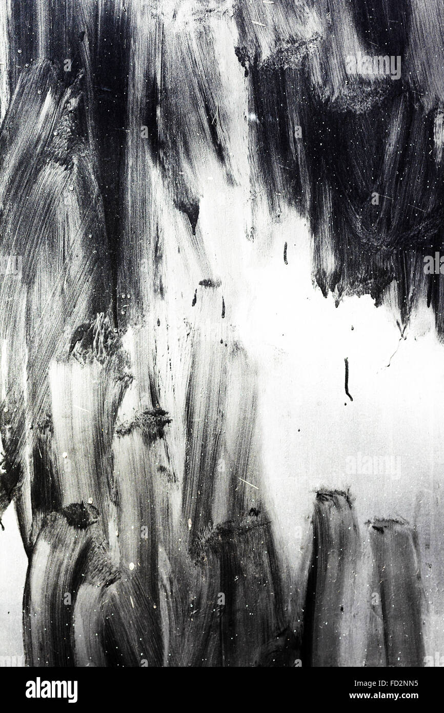 Creative background careless brush strokes dark paint, abstract textured background with flares and cracks. Grungy - Stock Image