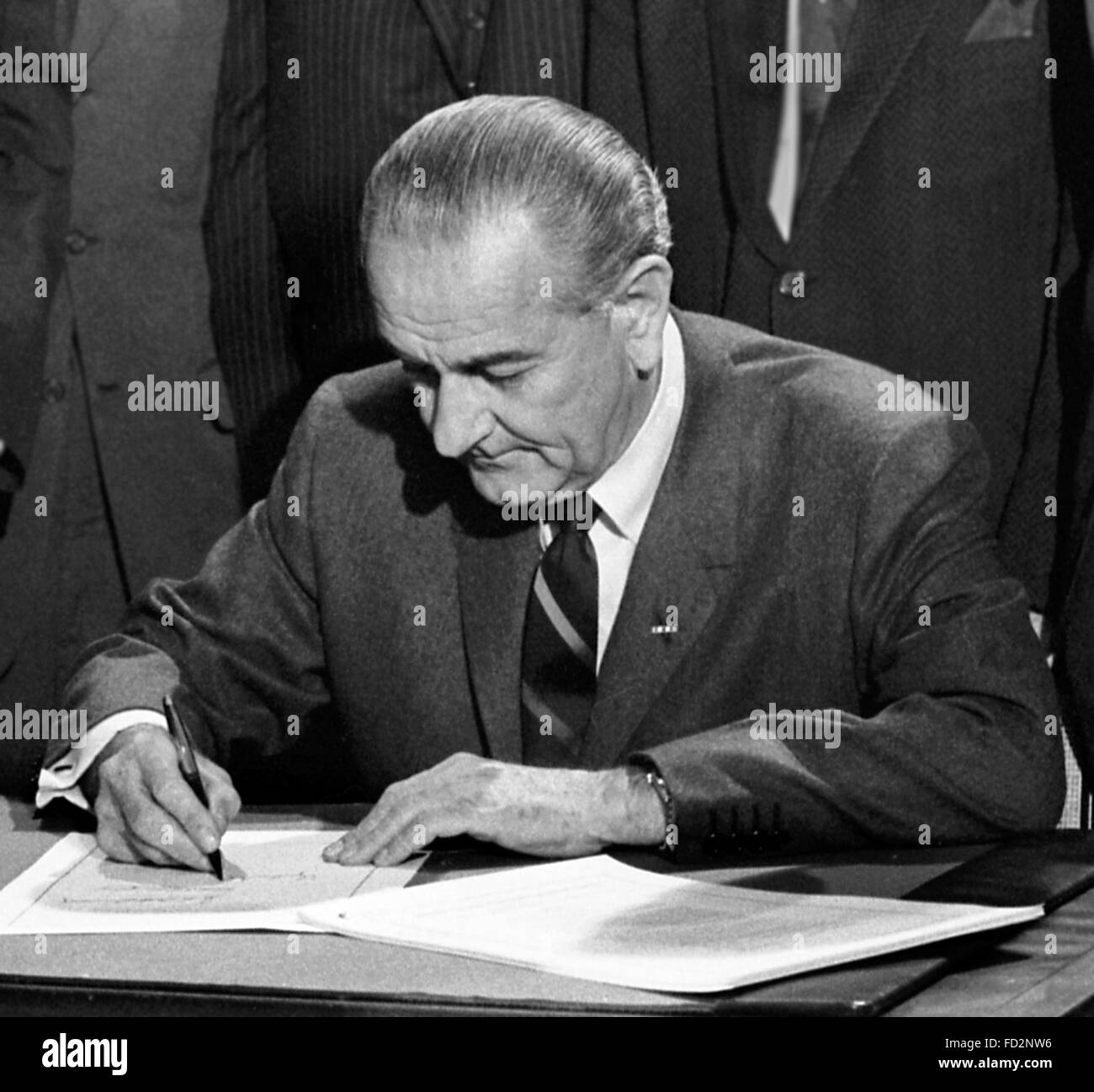 Lyndon B Johnson, the 36th President of the USA, signing the 1968 Civil Rights Act, 11th April 1968. Photo by Warren Stock Photo