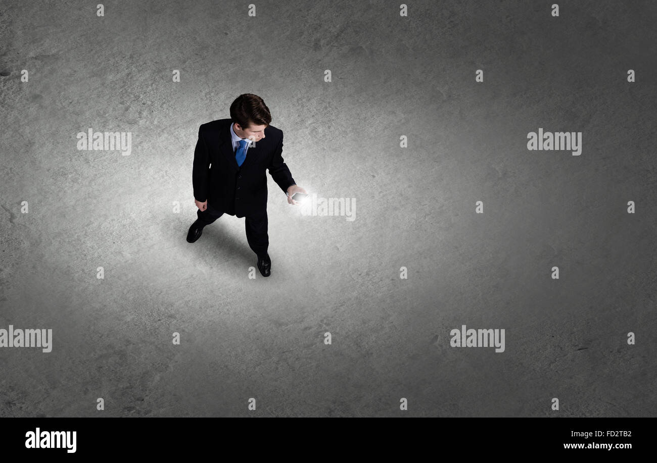 Top view of young businessman using mobile phone Stock Photo