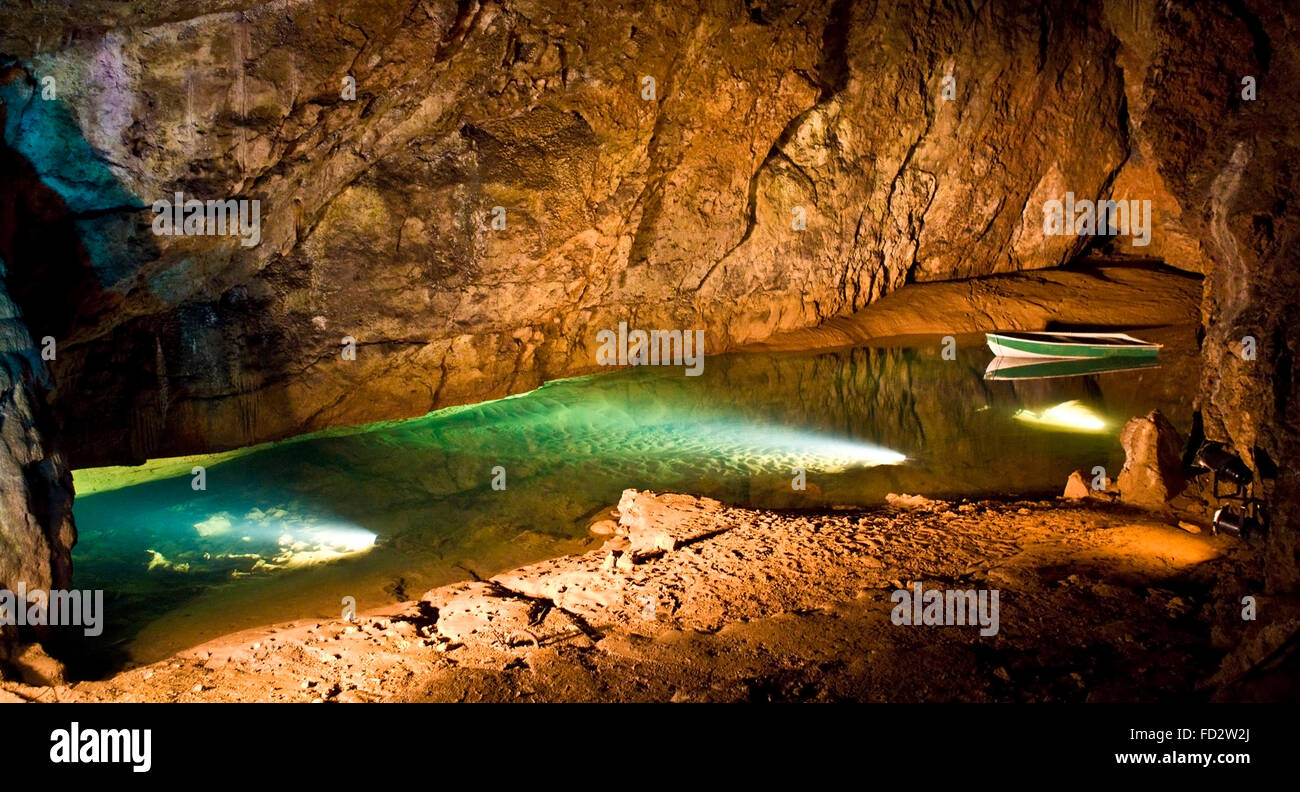 Underground cave interior with boat at Wookey Hole in Somerset - Stock Image