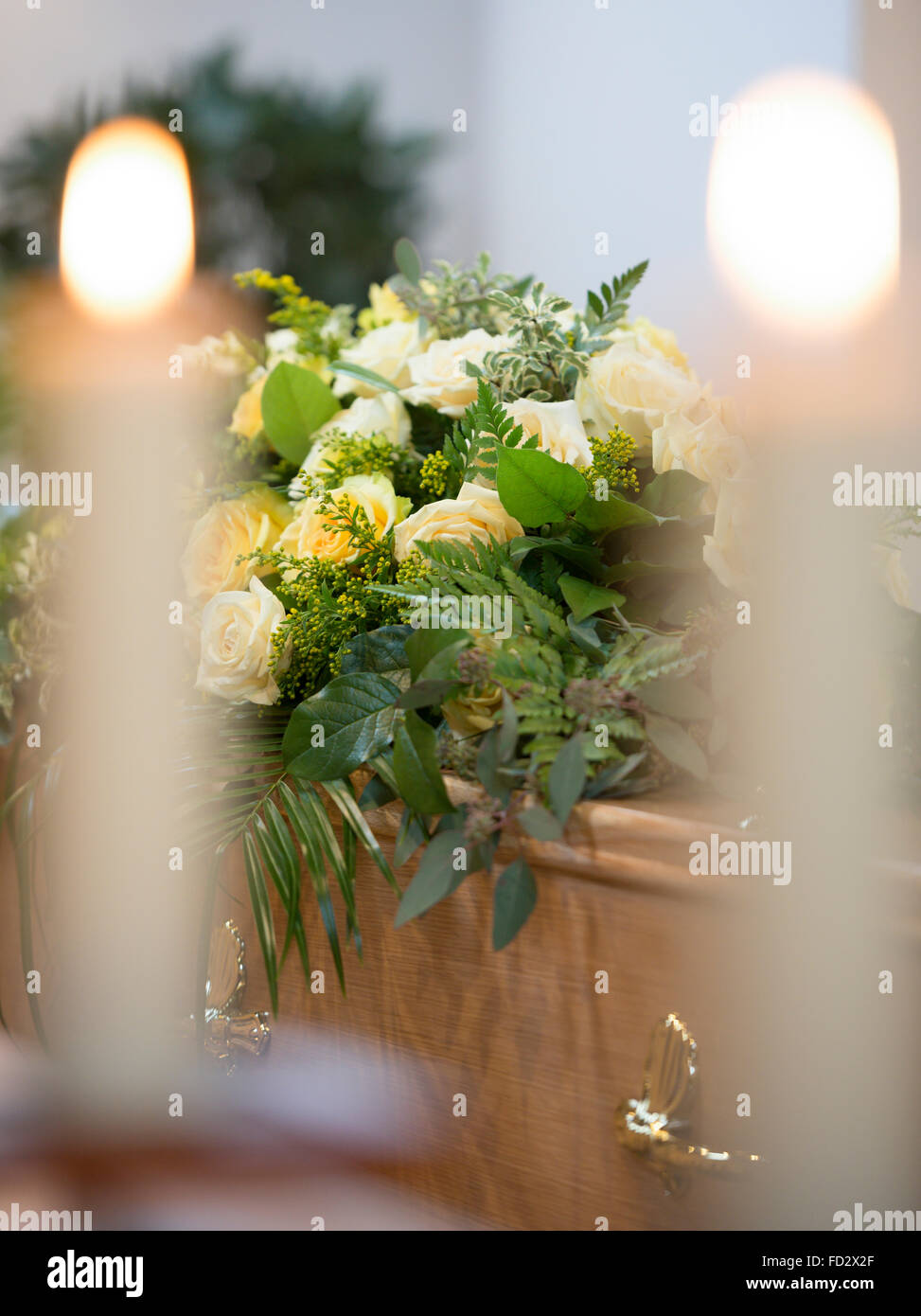 Coffin in a funeral service (staged service, not an actual funeral). - Stock Image