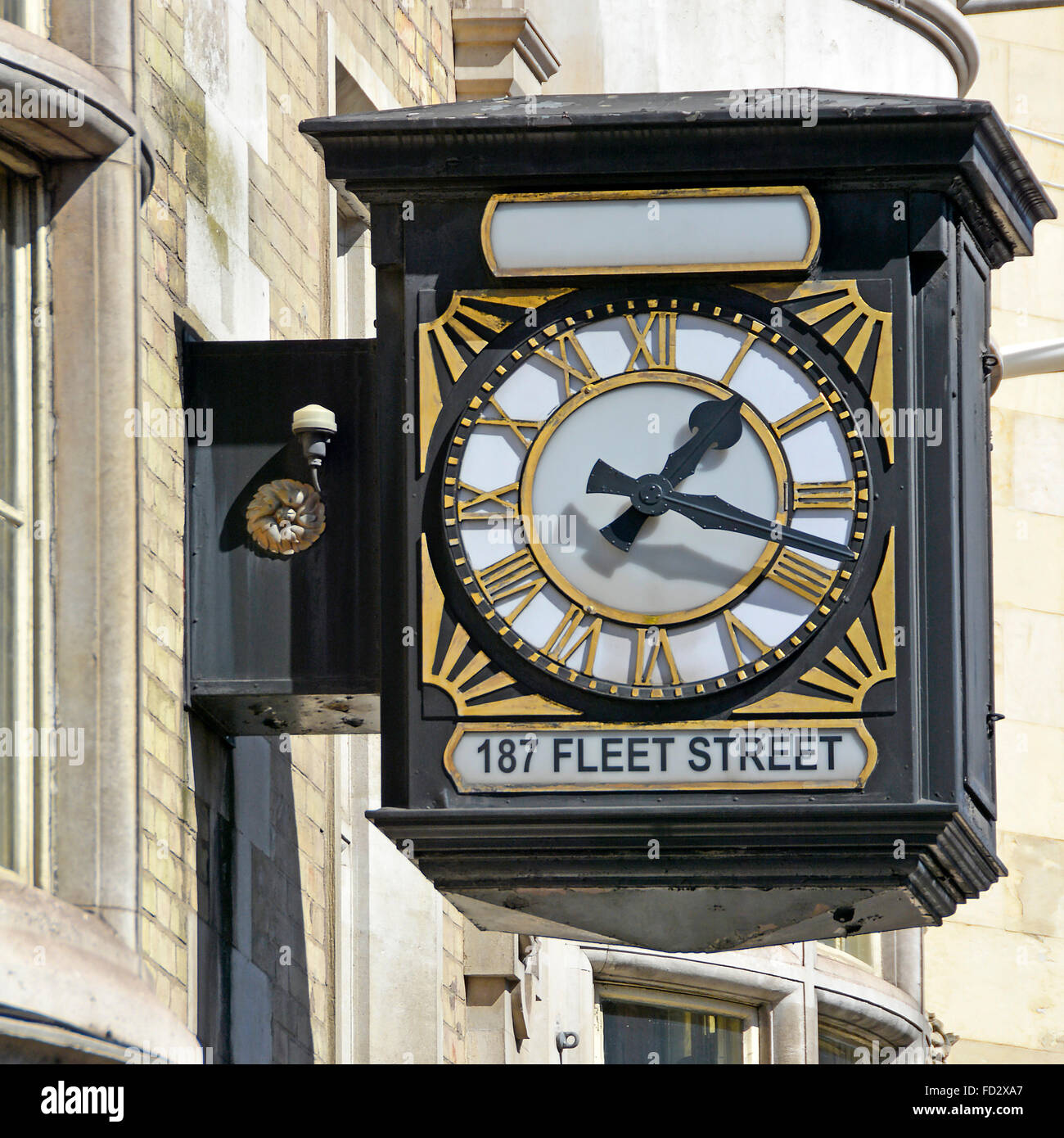 Outdoor wall mounted clock on offices (occupied by barristers) with Roman numerals at 187 Fleet Street - Stock Image