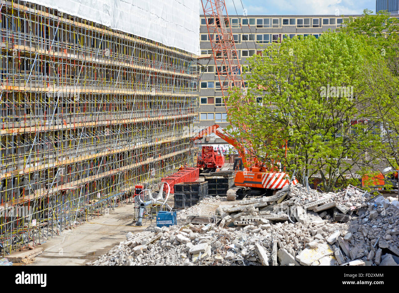 Demolition work in progress on the Heygate Estate with scaffolding and plastic sheeting erected to assist safe removal - Stock Image