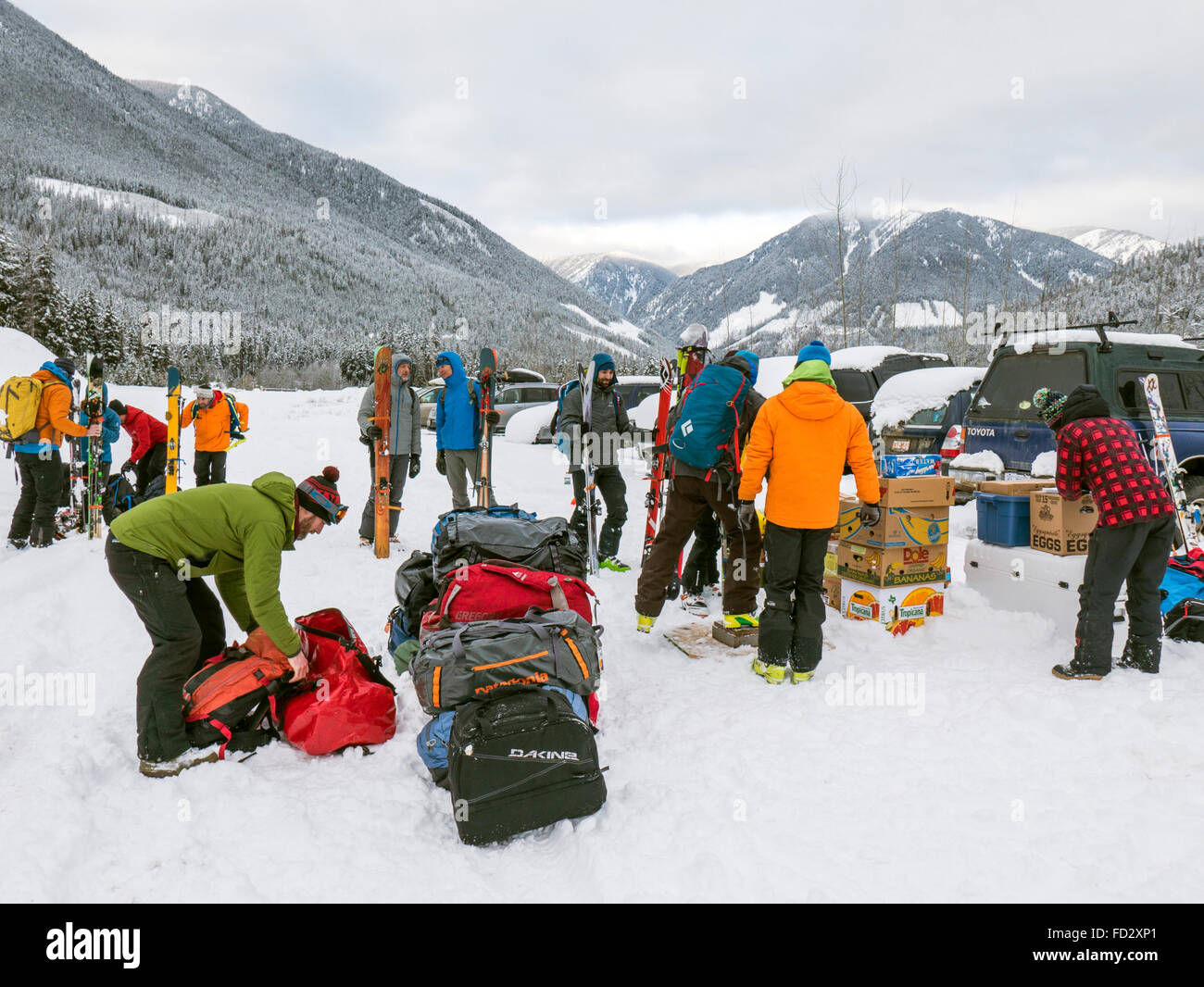 Back country skiers weigh and prepare provisions for helicopter transport to remote Mount Carlyle Lodge; British - Stock Image