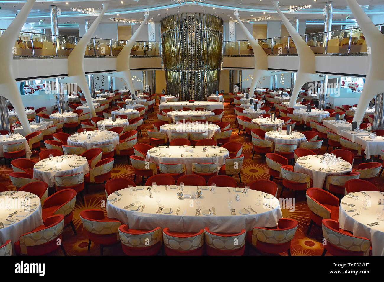 Cruise ship liner interior view of design of luxury restaurant place settings at tables & chairs prepared for evening of fine dining Mediterranean Sea Stock Photo