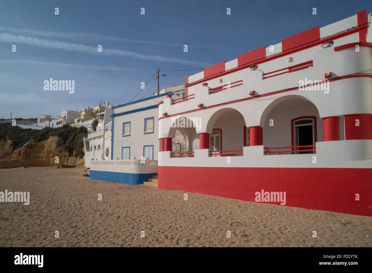 Houses on the beach at Carvoeiro in the Algarve region of Portugal. Stock Photo
