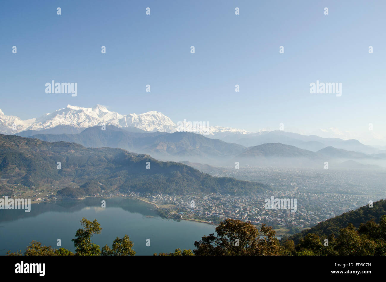 Machapuchare (Fish Tail Mountain),Annapurnas and phewa lake taken from Japanese peace pagoda, Pokhara, Nepal - Stock Image